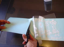 Lift and cut the wax paper